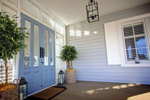 Front porch with composite wall cladding and composite decking