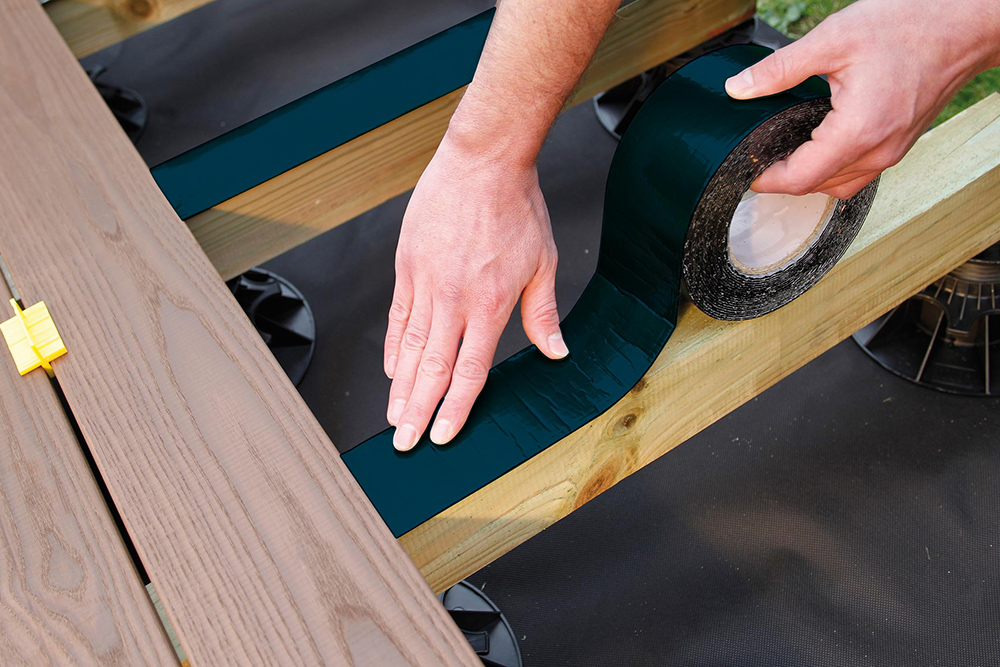 Applying joist tape to a deck in Australia