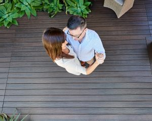 couple dancing on their composite deck